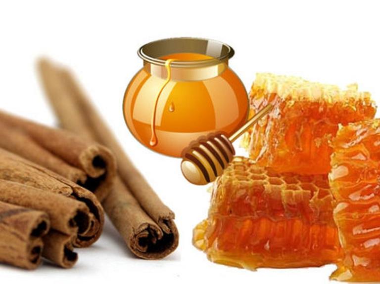 chữa thoái hóa đốt sống cổ bằng thuốc nam từ mật ong và bột quế