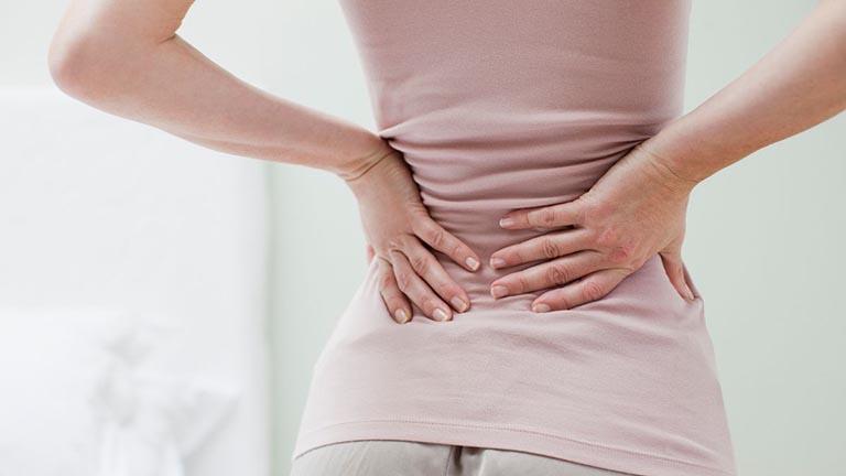 đau lưng khi mới thụ thai